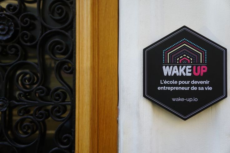 Sign at the entrance of Wake-up.io